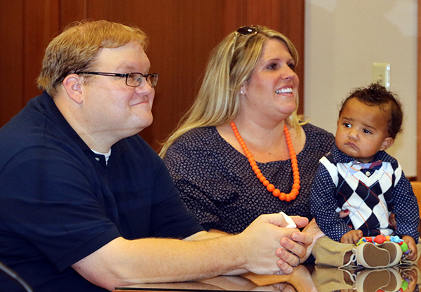 Rob and Alicia Henson sit in Hamilton County Probate Court with their new son Oliver, during his adoption finalization on Oct.3, 2016.